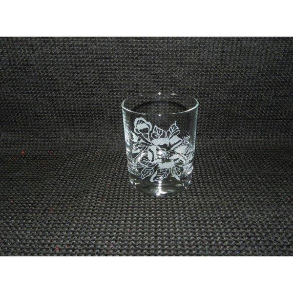 whiskyglas med blomstermotiv